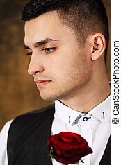 man with red rose