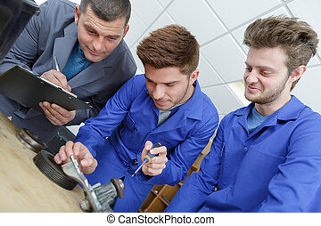a man with two apprentices