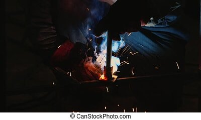 a man working in a factory with welding