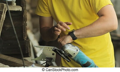 A man working on a smart watch, puts aside smartwatch and ...