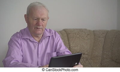 A man working with a tablet in a room 4k