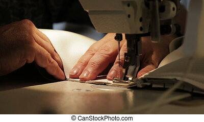 A man works for a sewing machine.
