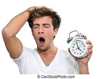 a man yawning