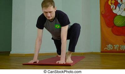 A man yoga makes a healthy stretching in the studio