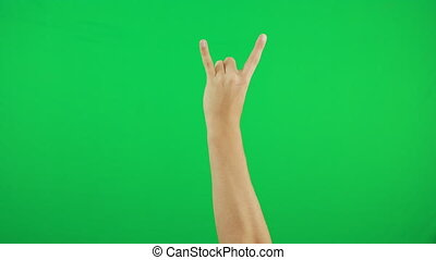 A man's cool gesture on a green background