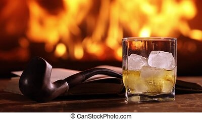 A man's hand pours some whisky into a glass - A man's hand...