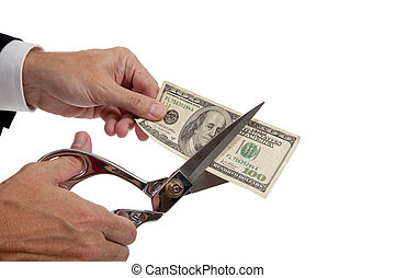 A man's hands cutting a $20 bil on a white background
