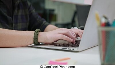 A Man's Hands Typing on the Laptop Indoors