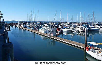 A marina with boats and blue sky.