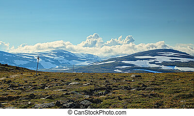 A marked trail on the barren plains near mount Nuolja, Lapland.