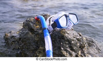 a mask and snorkel on the beach near the sea 4k, slow...