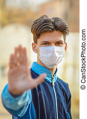 masked man from coronavirus and air. Protection against PM 2.5 air polluted from the virus in Europe and Asia