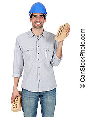 A mason carrying bricks.
