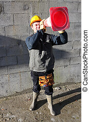 a mason using a road cone as binoculars