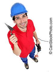 A mason with tools.