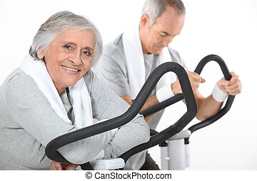 A mature couple exercising.