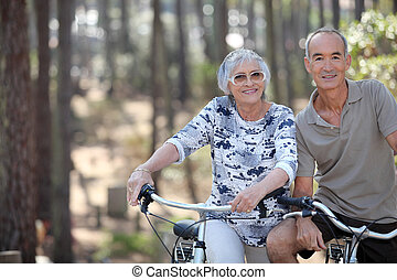 A mature couple on a bike ride.