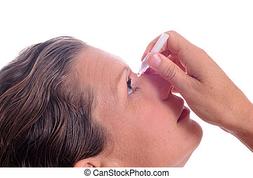 a mature woman applying eyedrops in front of a white background