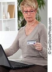 A mature woman doing online shopping.