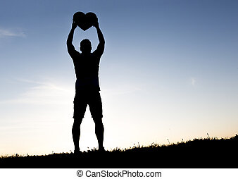 men hands holding hearts silhouette on Silhouette sunset