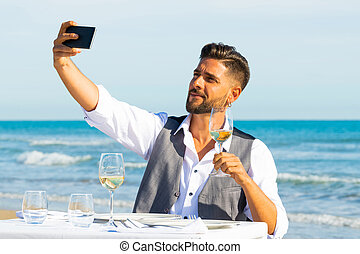 A men make a selfie on the beach