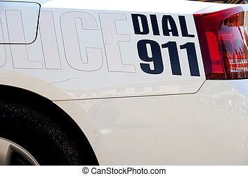 Dial 911 - A message on the back of a police car: Dial 911.