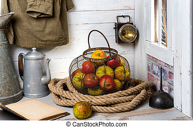 metal basket with beautiful apples