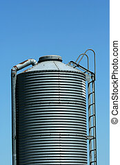 Metal feed silo - A Metal feed silo against blue sky