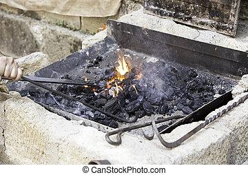 A metal forging iron