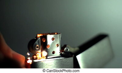 A metal lighter being ignited and its flame shot in super slow motion with the sony FS700 high speed camera