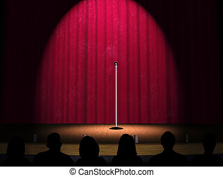 A microphone on a stage with a spotlight on it and an ...
