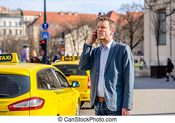A middle age businessman at taxi station