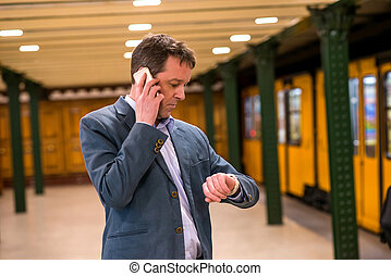 A middle age businessman in the subway