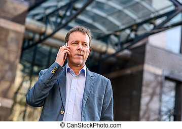 A middle age businessman with a phone