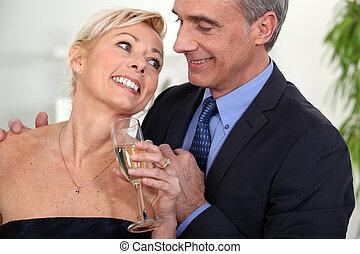 A middle age couple celebrating.