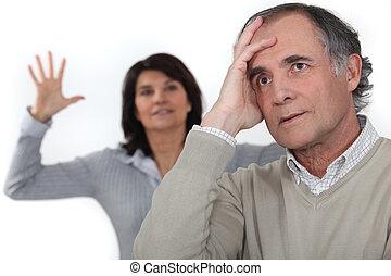 A middle age couple having an argument.