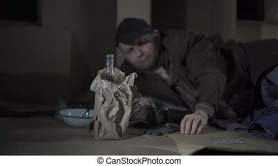 A middle-aged homeless man became alcoholic because of his situation.