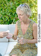 a middle-aged woman has a headache