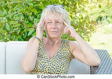 a middle-aged woman with a headache