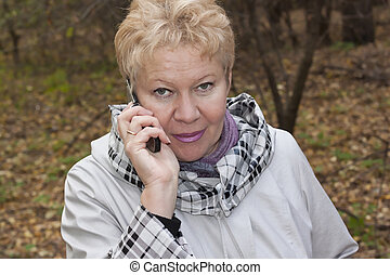 A middle-aged woman with telephone
