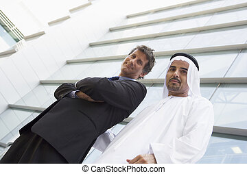 A Middle Eastern businessman and a Caucasian businessman...