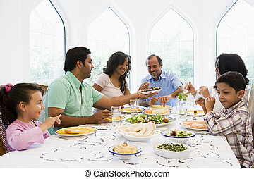 A Middle Eastern family enjoying a meal together