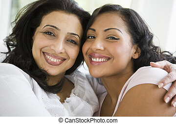 A Middle Eastern woman with her daughter-in-law