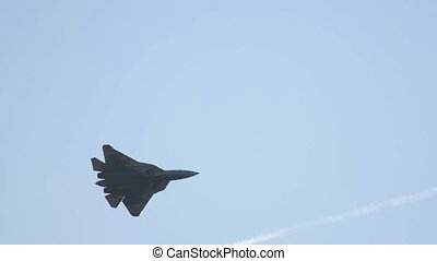 A military fighter jet flying in the blue sky