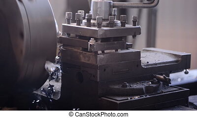 A milling machine cuts the workpiece with layers of metal shavings. Work longitudinal machine factory production