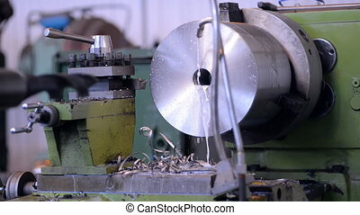 A milling machine operator prepares the machine to the beginning of works. cleaning of metal shavings