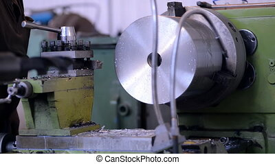 A milling machine operator prepares the machine to the beginning of works. Replacement blade cutter head.