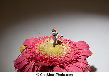 A mini of figure of lover on flower