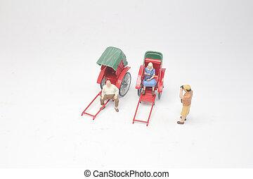 a Mini of vintage oriental rickshaw cab