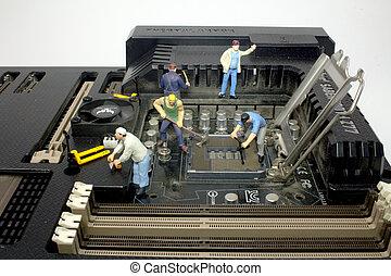 a mini of Workers repair computer detail.